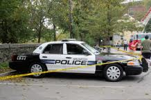 Arlington police cruiser with crime tape photo